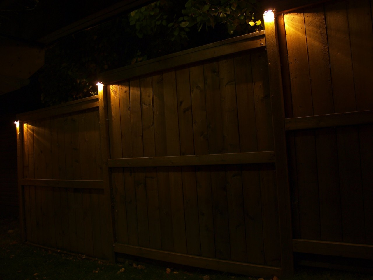 Cup Lights Mounted On Fence Posts Illuminate The Way